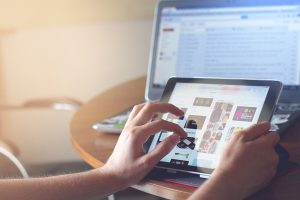 A woman searching is WordPress the best platform for SEO on a tablet.