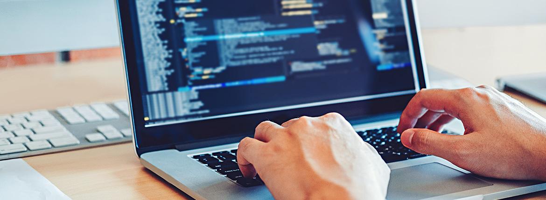 A man typing on laptop