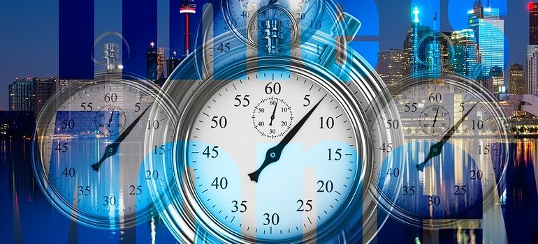 several clocks and the words time is money written in blue letters because time is an important factor when determining the fastest WordPress theme