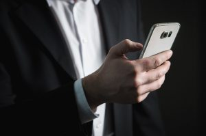 A person trying to add social media share buttons on a phone.