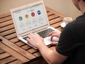 A man looking at a website after managing to create a custom WordPress theme.