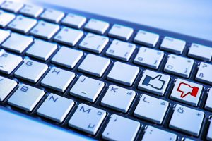 A keyboard with a like and a dislike on it.