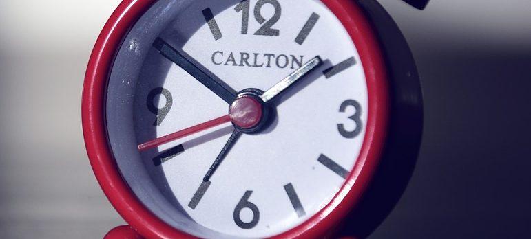 A red alarm clock.