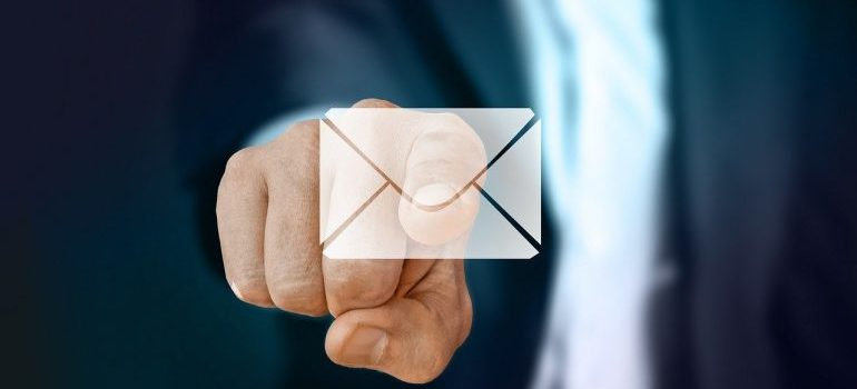 A man pointing at an icon of an email.