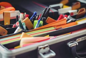 Pens and stationary organized in a holder.