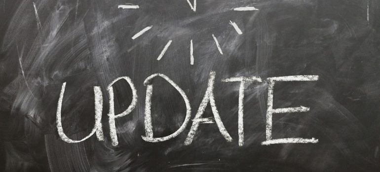 Update written on a blackboard.