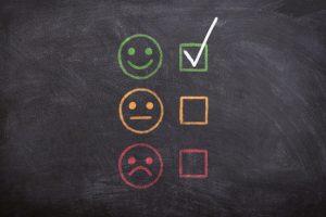 Three emoticons on a board.