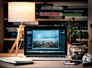 Laptop running PhotoShop.