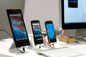 Three different-sized smartphones next to each other.