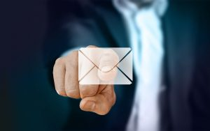 A man pointing at an email icon.