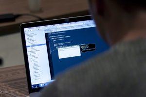 A developer adding a line of code.
