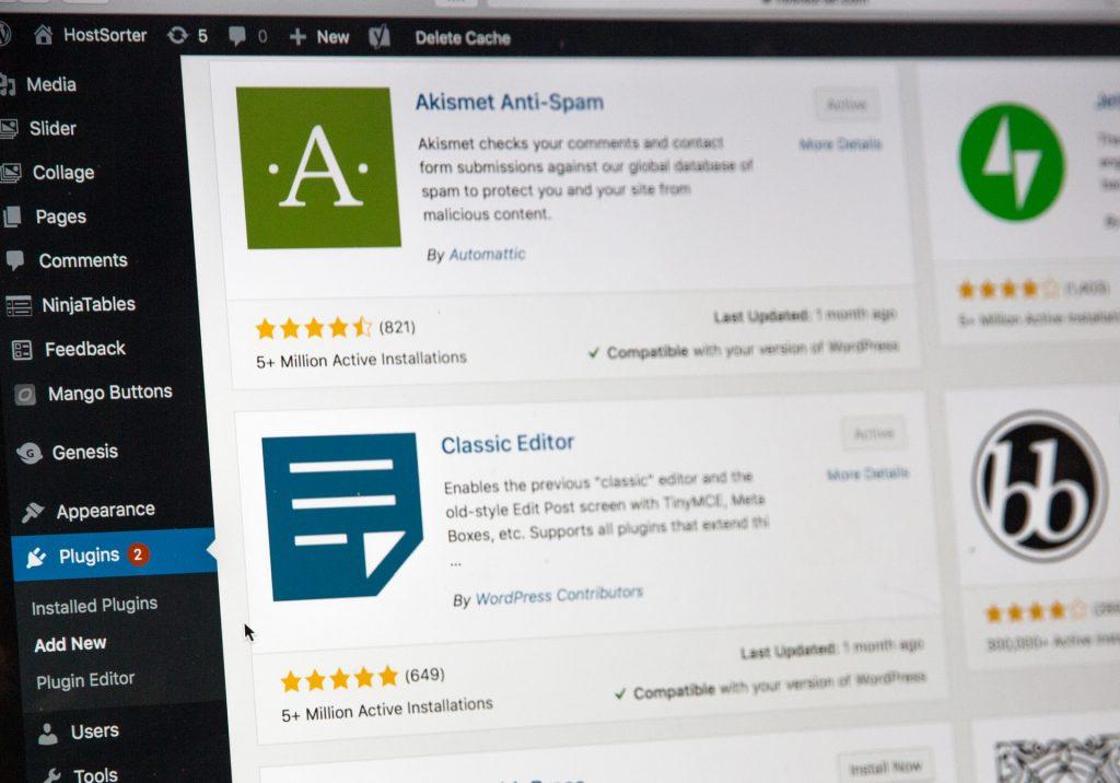 Akismet plugin in WordPress on a laptop screen