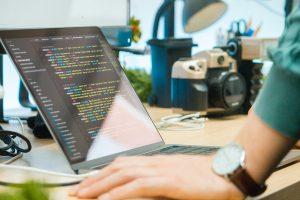 A man learing how to create custom shortcodes in WordPress.