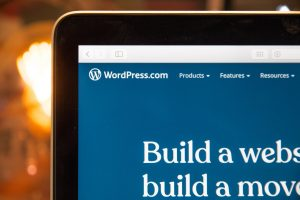 A computer monitor with a WordPress site on it