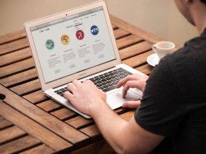 A person visiting a website that has a dropdown menu.