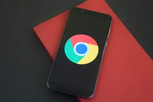 A mobile phone with a Google Chrome icon on it