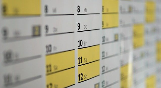 A calendar with numbers and days.