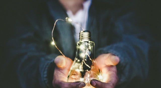 Man holding a lightbulb.