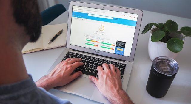 Man looking at statistics on a WordPress plugin.