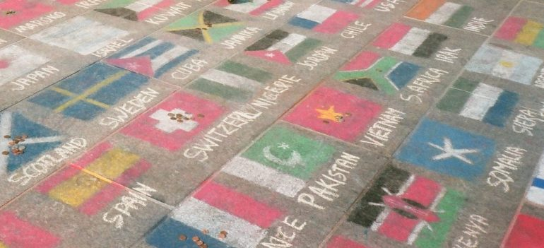 Different country flags written in chalk.