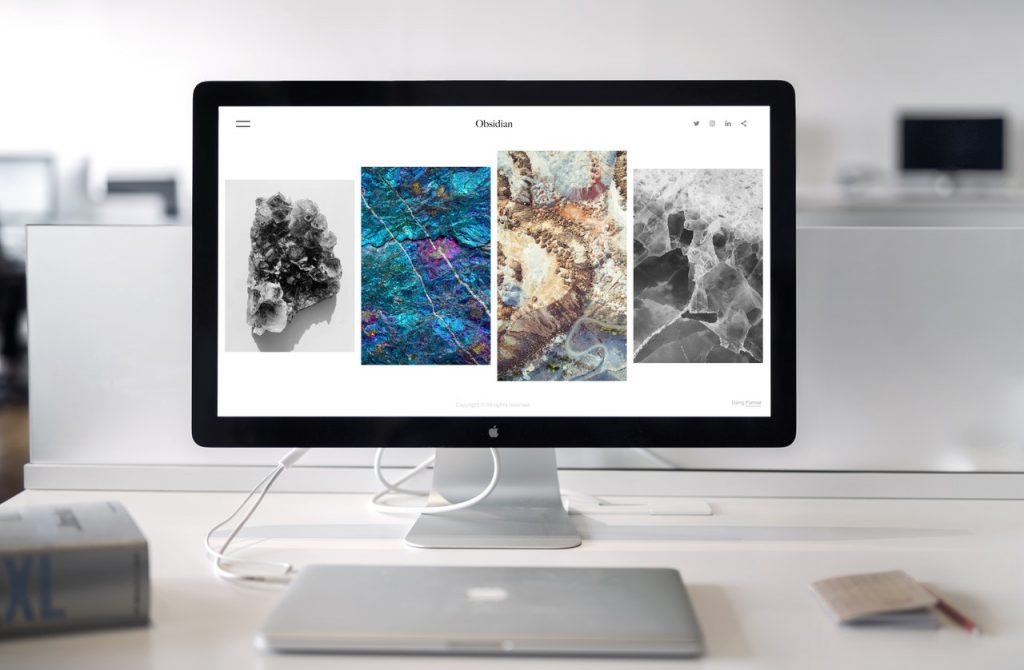 a mac monitor displaying themes