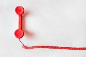 A red cord and a phone handset.