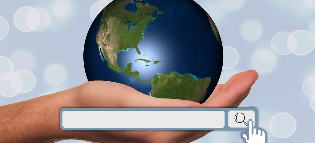 A globe on a palm and a search bar.