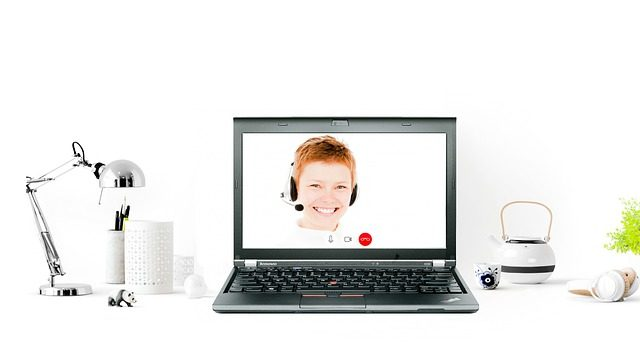 Customer service personnel on a laptop screen.