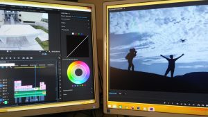 Using a video editor to edit a video on two monitors.