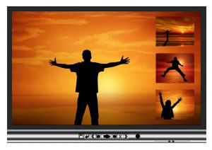 Playing video with a simple video player, showing a silhouette of a man in a sunset with arms wide open.