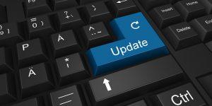 "A blue ""Update"" button on a black keyboard."