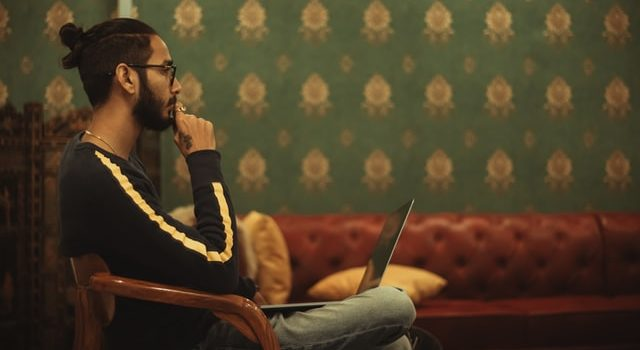 A man thinking about how to improve organic click through rate.