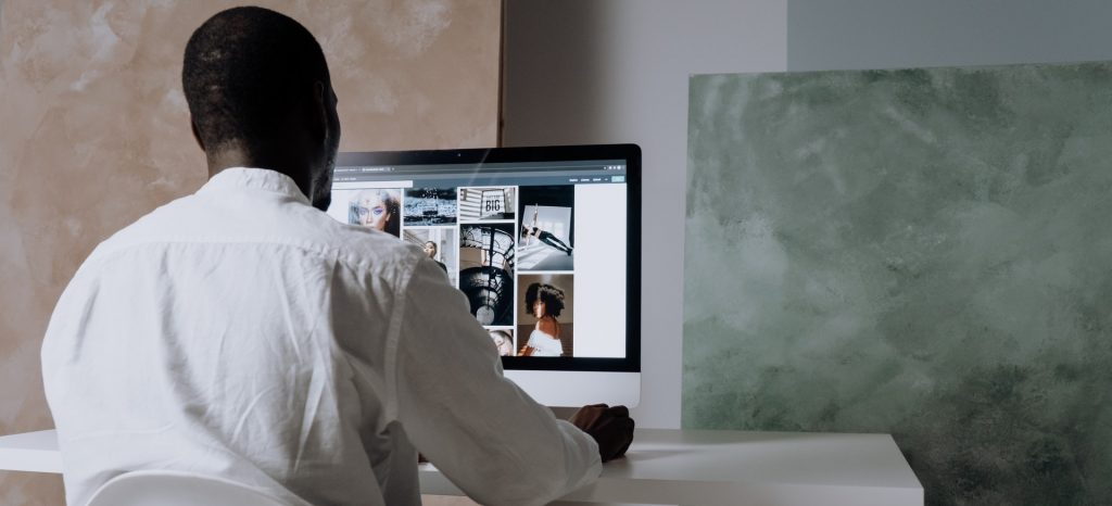 A person looking at a website with a lot of images.