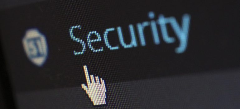 A mouse hovering over security tab in WordPress, representing one of the reasons to add a custom Login URL in WordPress.