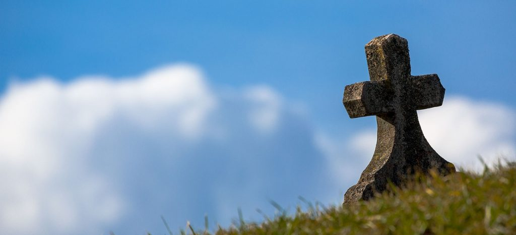 A cross sitting on a hill representing Christianity, and showing one aspect of the importance of logo design.